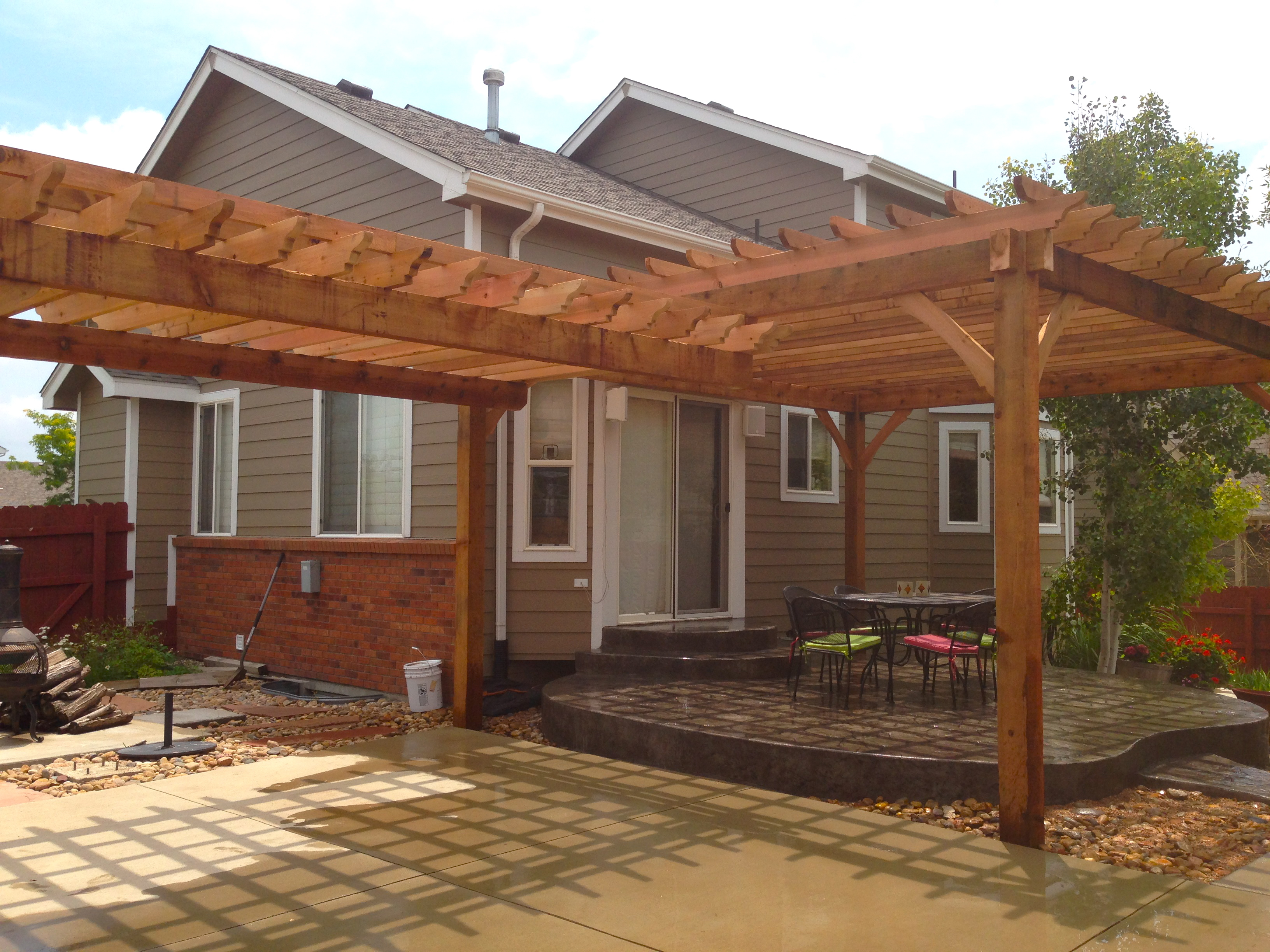Centered Beam Pergola Built To Follow The Contouring Radius Of The Patio.